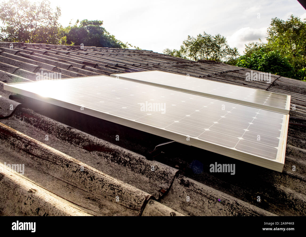 Small Solar Panel On Roof Of House In The Countryside Stock Photo