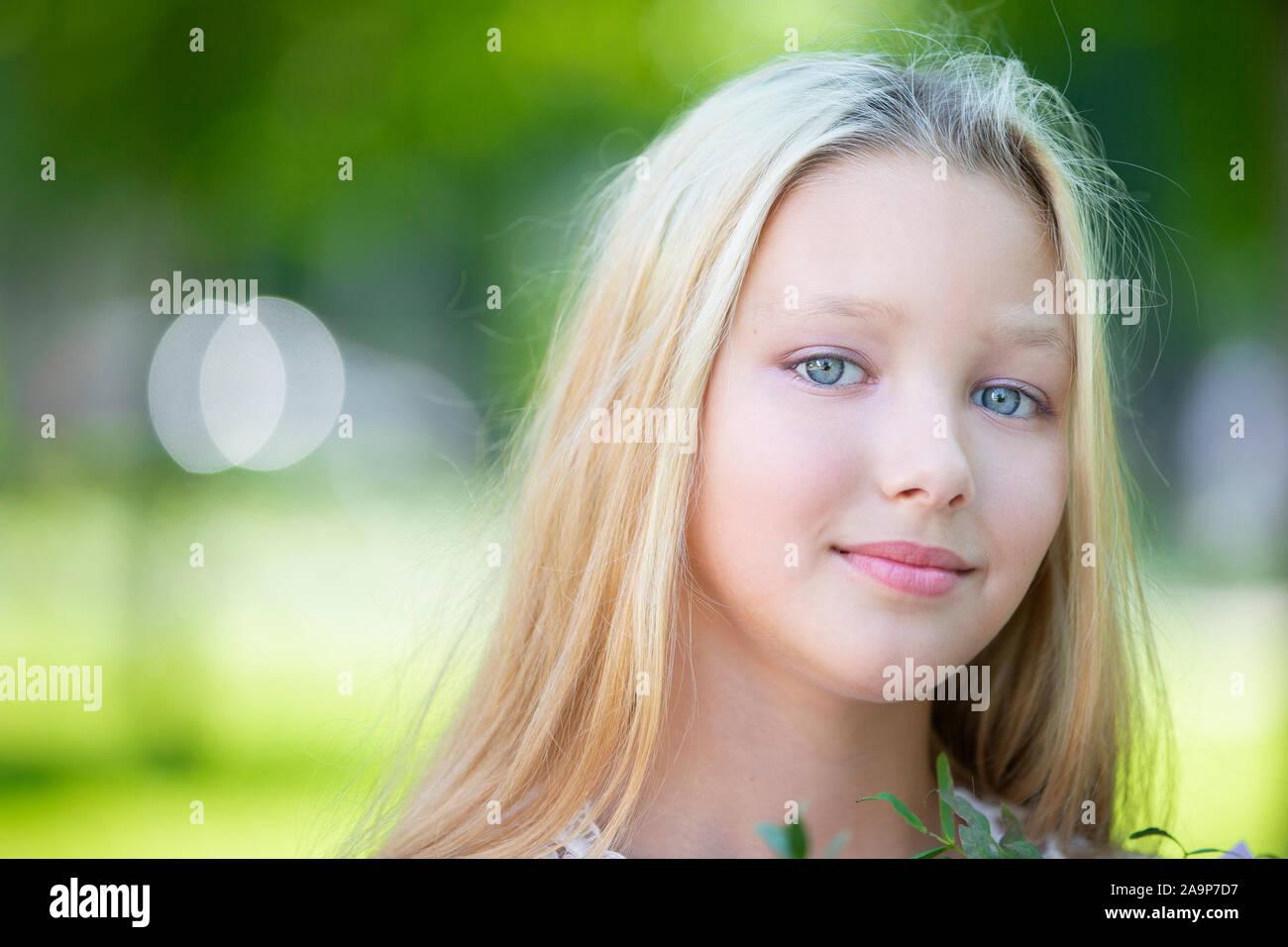 Portrait of a beautiful teenage girl. Ten year old blue-eyed girl Stock Photo