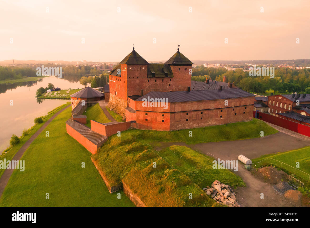 Ancient fortress against the backdrop of the cityscape on a dawn (shooting from a quadrocopter). Hameenlinna, Finland Stock Photo