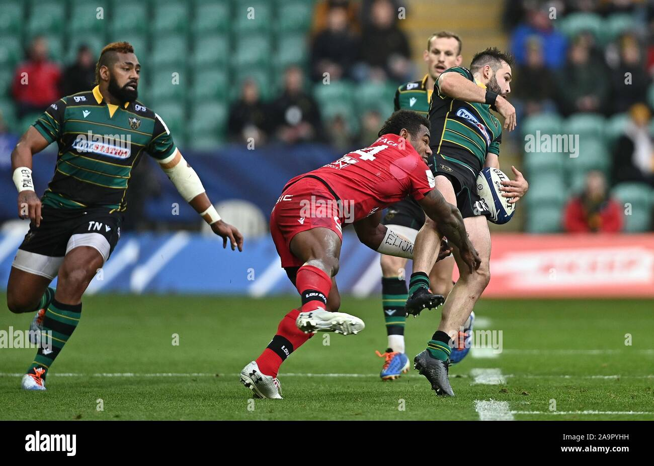 Northampton, UK. 17th Nov, 2019. Cobus Reinach (Northampton Saints) catches as he is tackled by Josua Tuisova (Lyon). Northampton Saints v Lyon. Heineken Champions Cup. Franklins Gardens. Northampton. Northamptonshire. UK. Credit Garry Bowden/Sport in Pictures. Credit: Sport In Pictures/Alamy Live News Stock Photo