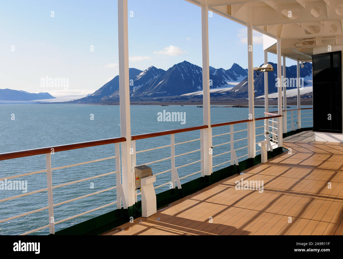 The promenade deck of a cruise ship anchored in the Kongsfjorden off Ny Alesund on the island of Spitsbergen. Stock Photo