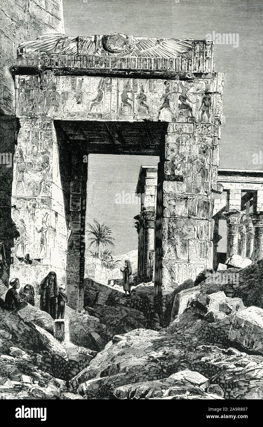 Shown here is the Temple of Isis at Philae. The image dates to around 1905. The island of Philae was located in theNile Riverat the First Cataract, south of the present Aswan dam; it is now totally submerged, following the construction of the Aswan dam.This temple, thought to be the single most beautiful preserved ancient Egyptian temple, housed amammisi,or birth house, built to celebrate the birth of Harpocrates to Isis and Osiris. The Isis temple is of Ptolemaic date (304 b.c.e.–30 b.c.e.), specifcally about 280 B.C. Stock Photo