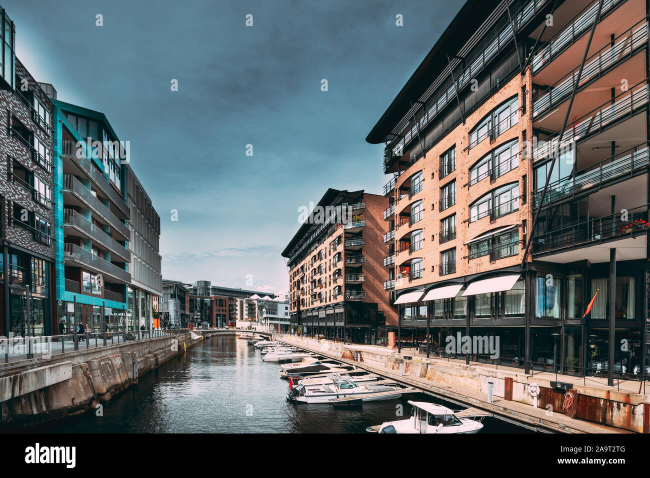 Oslo, Norway. View Of Residential Multi-storey Houses In Aker Brygge District In Summer Evening. Famous And Popular Place. Stock Photo