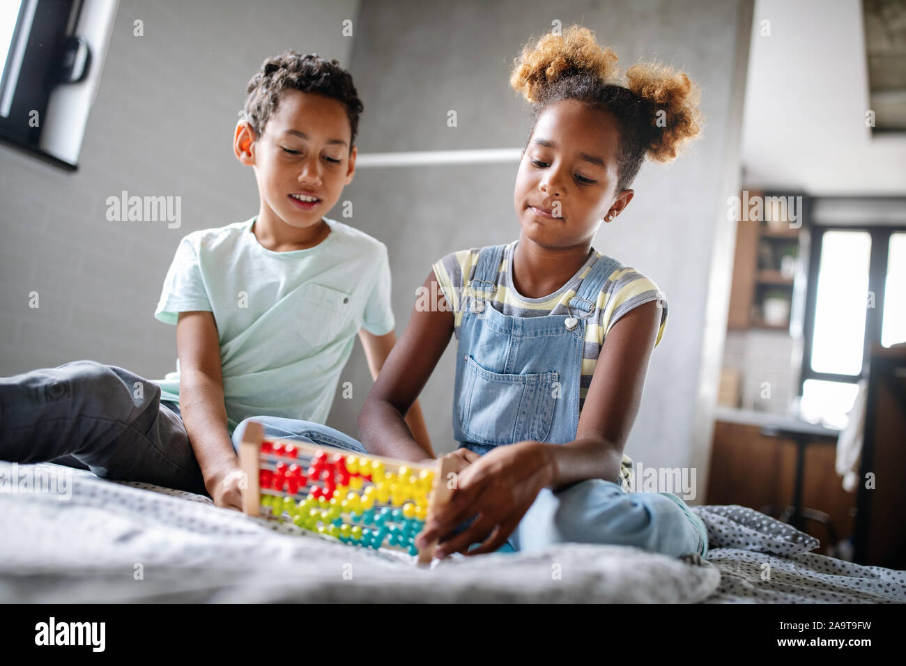 Children, education, plyaing happiness concept. Happy kids entertaining themselves at home Stock Photo