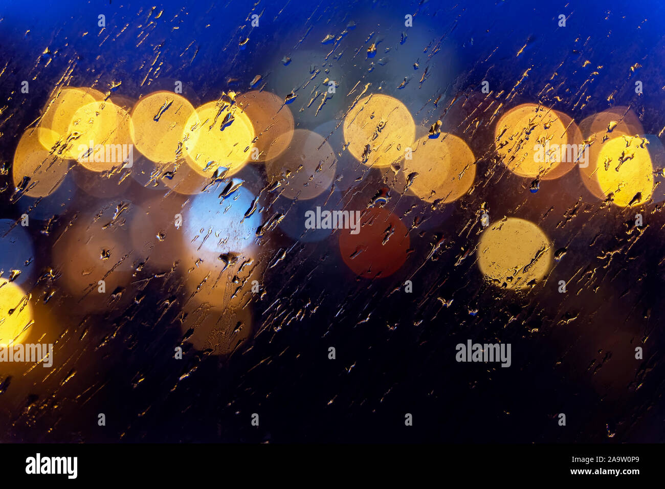 Abstract Blurred Colorful Background Wet Window In Rainy