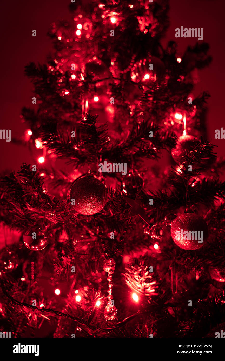 Christmas Tree With Red Lights Shiny Christmas Ornaments Are Glittering On The Tree Close Up Photo Stock Photo Alamy