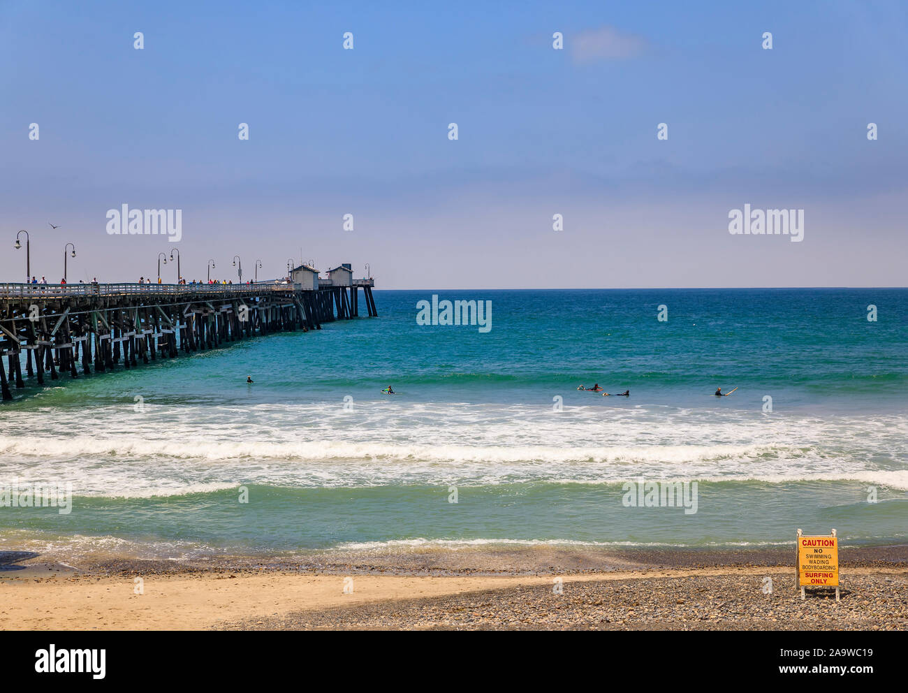 San Clemente, USA - July 03, 2017: Safety no surf warning sign on the beach in a famous California tourist destination with a pier in the background Stock Photo