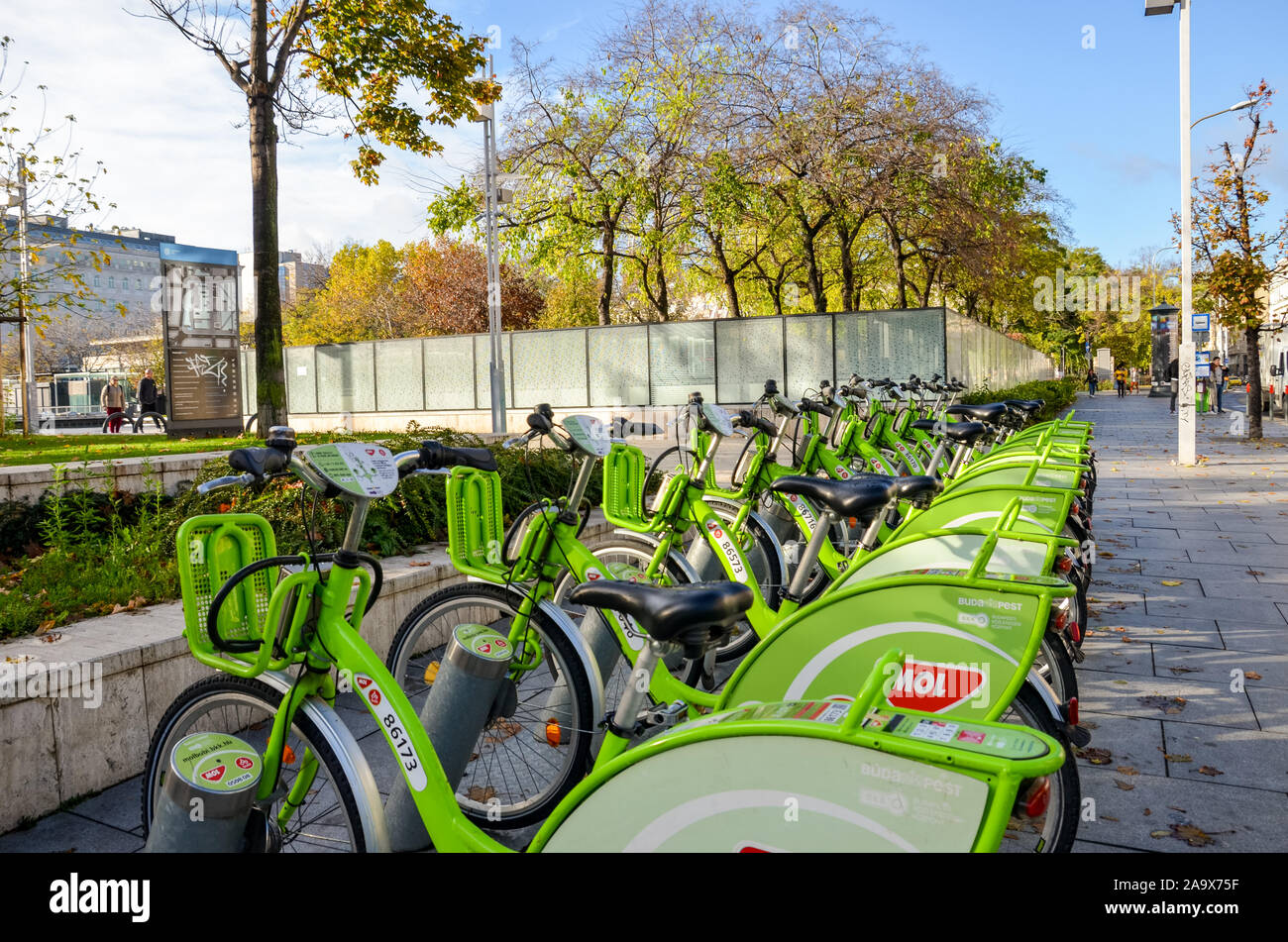 Budapest, Hungary - Nov 6, 2019: Public green bikes for rental in the center of the Hungarian capital city. Bike-sharing. Eco-friendly means of transport. Ecological measures in the cities. Bicycles. Stock Photo