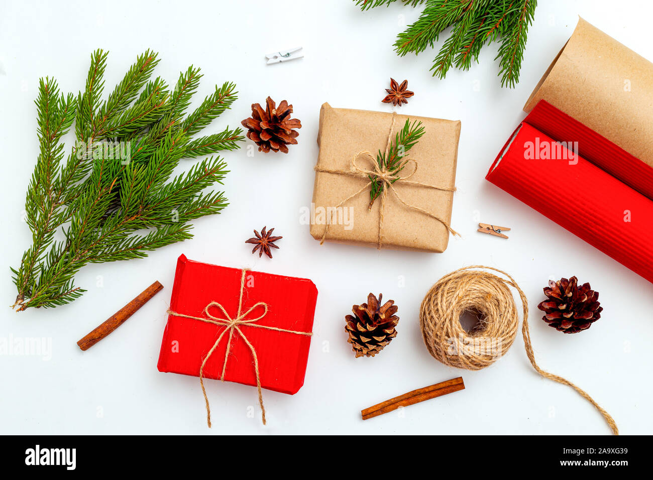 Christmas gift box hand made and  fir branches on white background. Christmas zero waste. Stock Photo