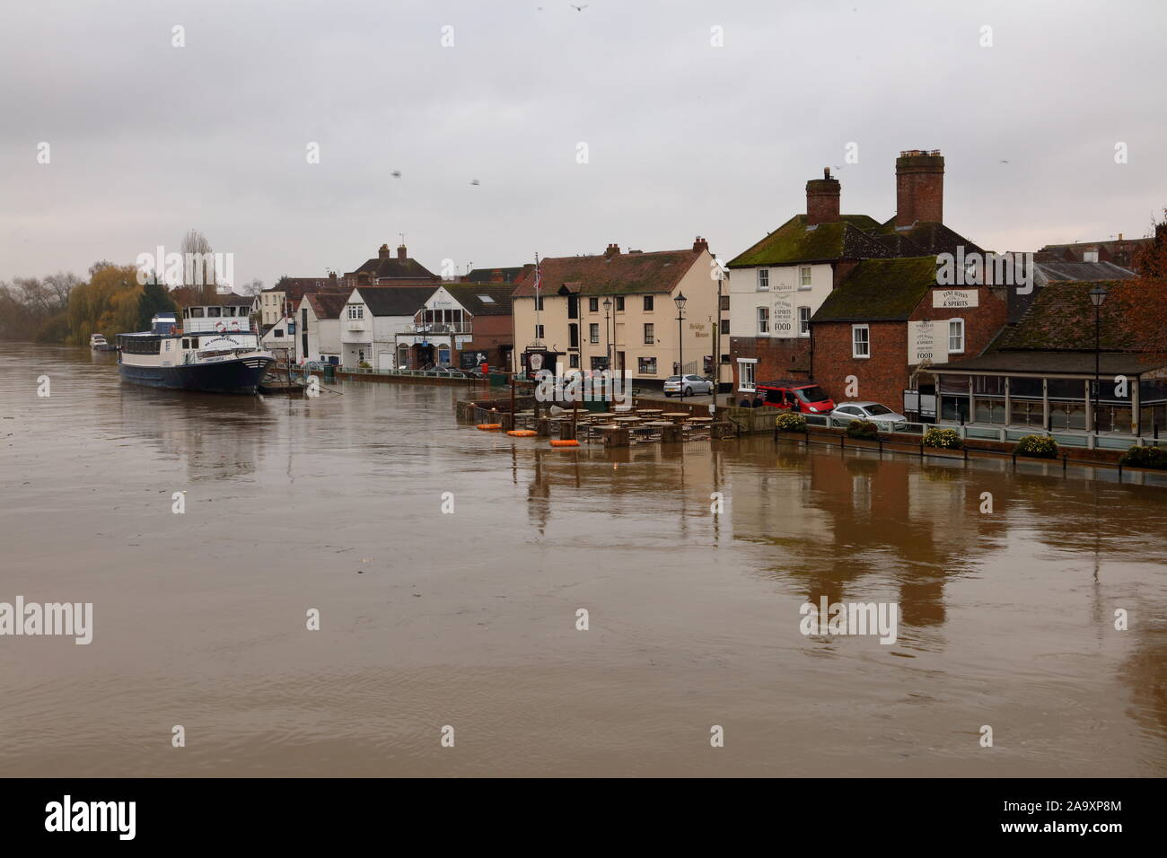 As the rains keep falling the barriers at Upton guarding the village from the Severn flood waters stand their ground despite the increasing waters. Stock Photo