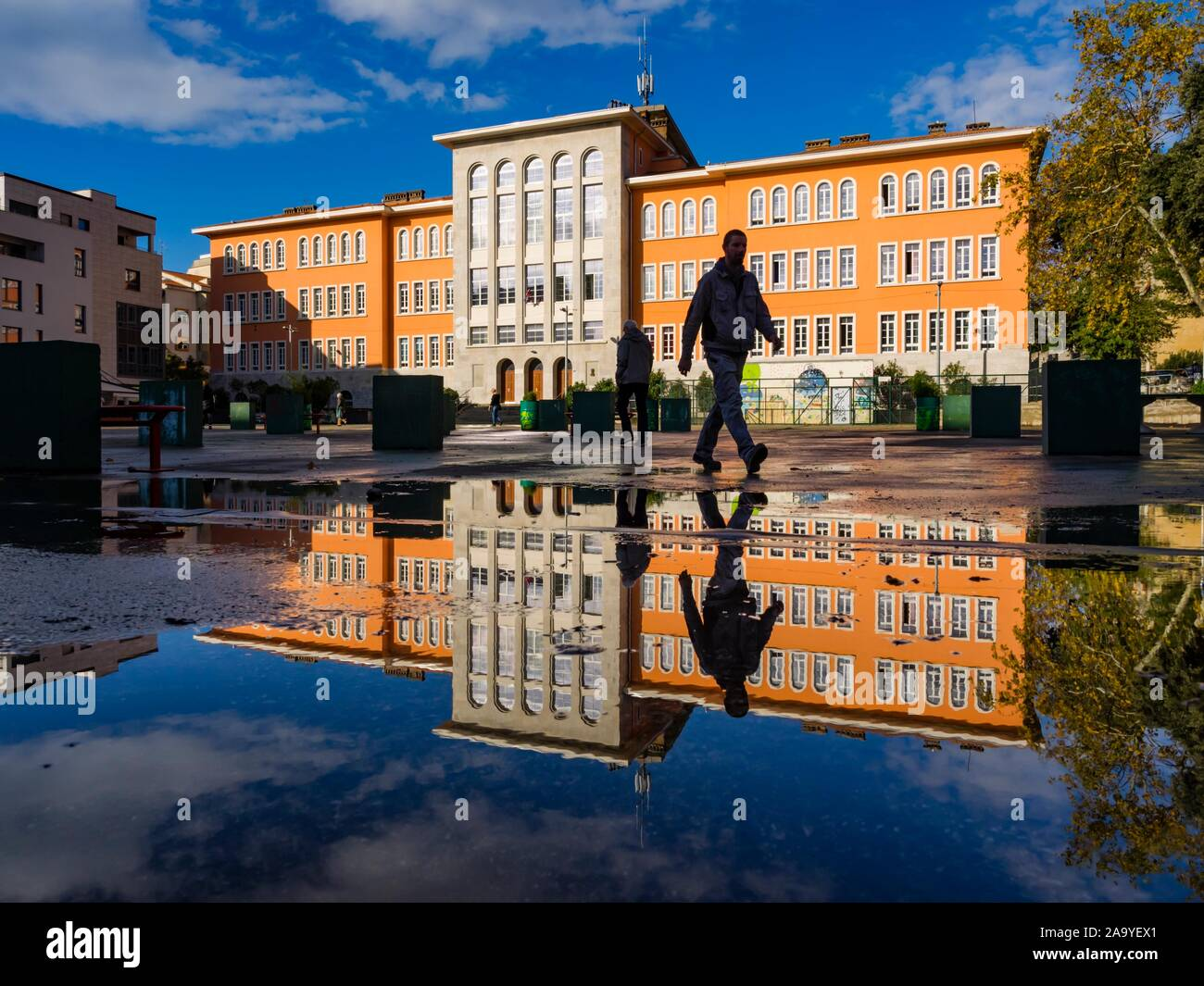 Elementary school Nikola Tesla in Rijeka in Croatia people walking by across frame Stock Photo