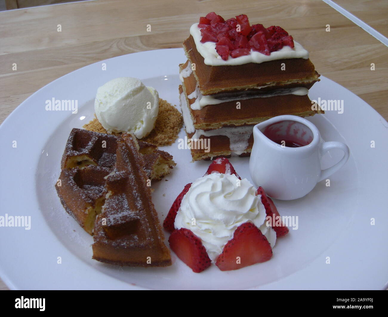 Chocolate Pancake With Ice Cream And Fresh Cream And Strawberries And Strawberry Sauce Stock Photo Alamy