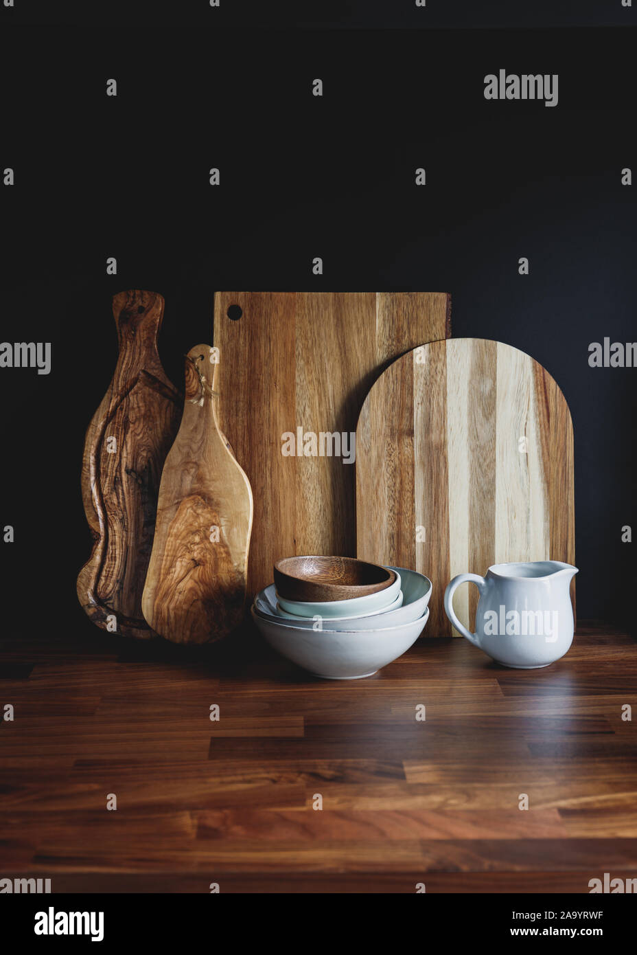 Set Of Wooden Cutting Board And Ceramic Dishes On A Wooden Kitchen Table Over Black Background The Concept Of Modern Style Rustic Kitchen Interior Stock Photo Alamy