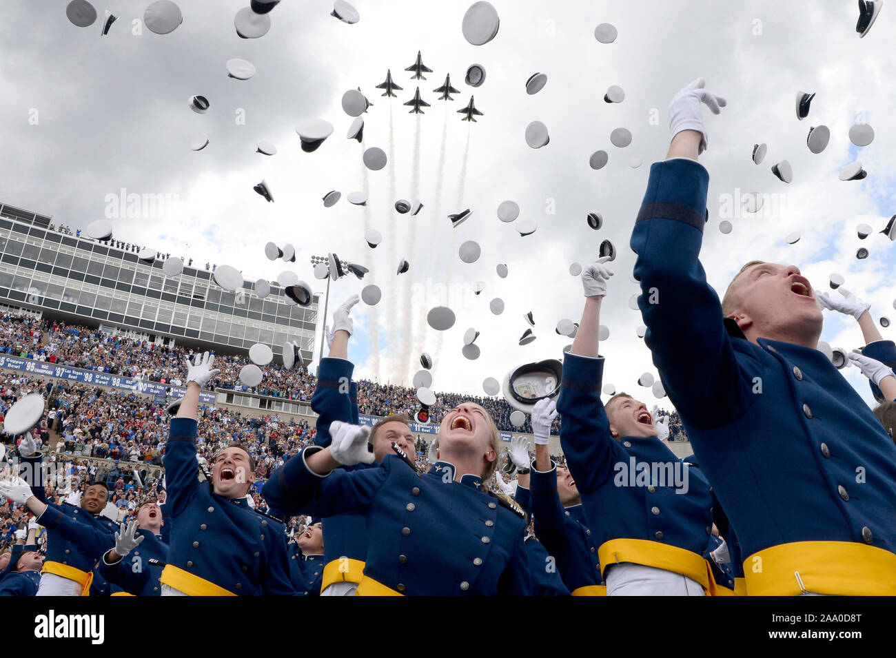 U.S. Air Force Academy Class of 2019 graduates toss their hats skyward as the U.S. Air Force Thunderbirds roar overhead during the graduation ceremony in Colorado Springs, Colo., May 30, 2019. During the ceremony 989 cadets crossed the stage to become the Air Force's newest second lieutenants. (U.S. Air Force photo by Darcie L. Ibidapo) Stock Photo