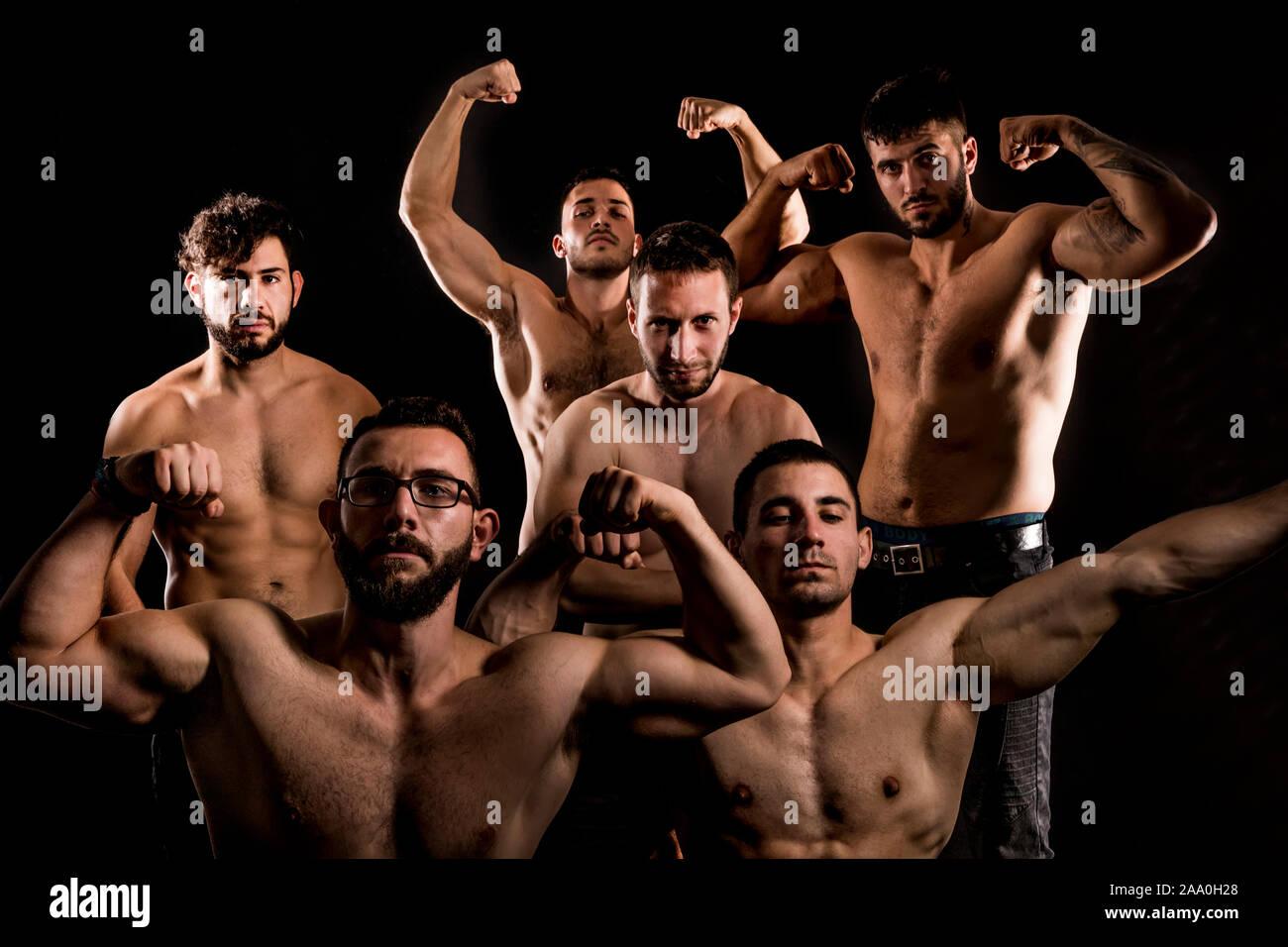 shirtless men group