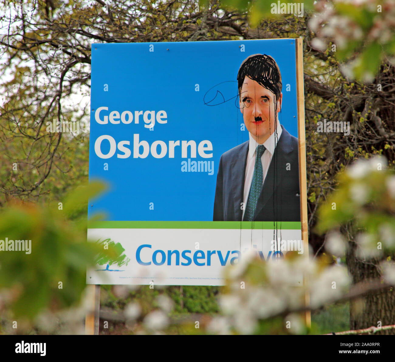 George Osborne defaced Conservative Election posters and publicity Knutsford Tatton Cheshire, North West England, UK Stock Photo