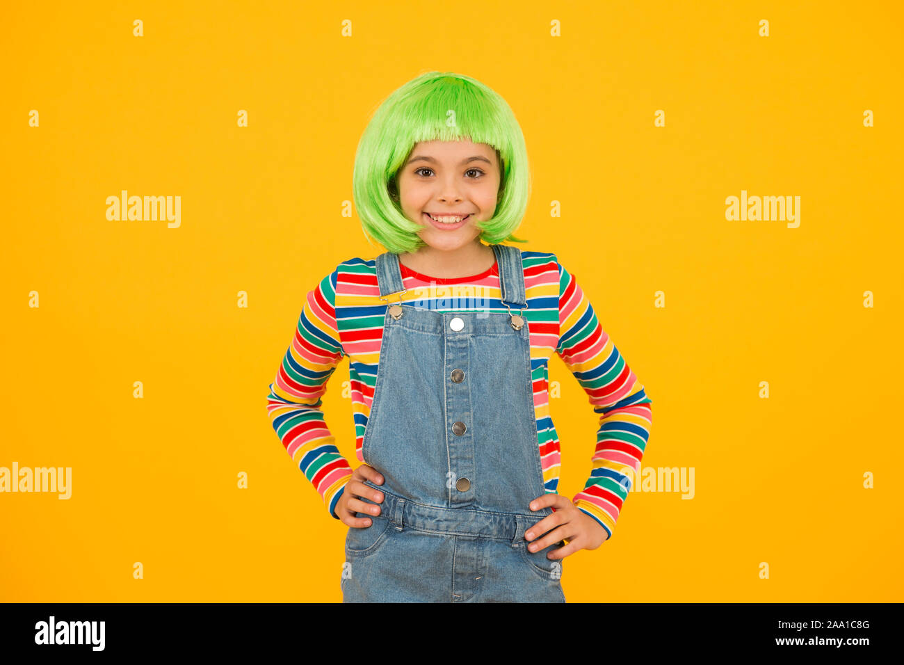 Appeal To Her Creative Style Happy Girl Wear Short Hair Style Wig Yellow Background Little Child Smile In Casual Fashion Style Fancy Style And Fashion Beauty Look Hair Salon Stock Photo