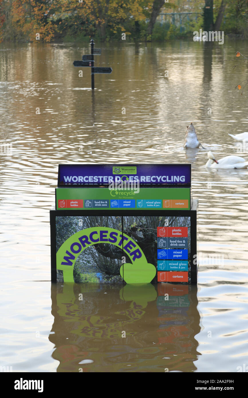 Recycling bin partly submerged by a flooding river Severn in Worcester, England, UK. Stock Photo
