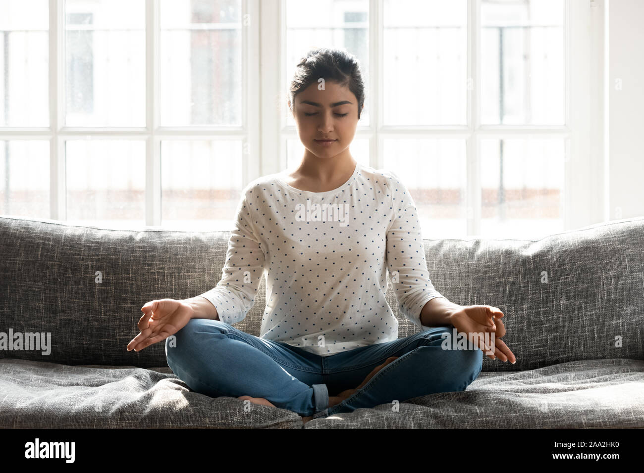 Mindful Young Indian Woman Doing Breathing Yoga Exercises Alone Stock Photo Alamy