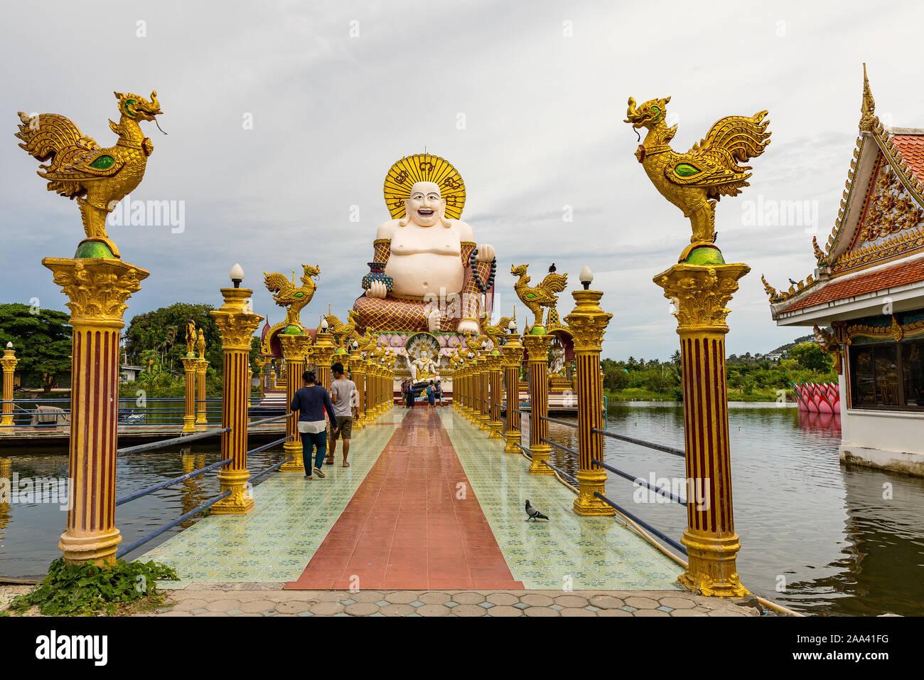 Wat Laem Suwannaram Chinese Buddhist Temple. Closeup of Giant statue of Budai against silver sky on Koh Samui. Thailand Stock Photo