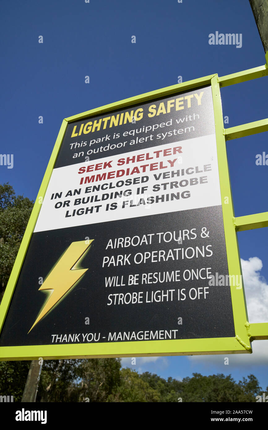 lightning storm safety warning sign at a tourist attraction in florida usa Stock Photo