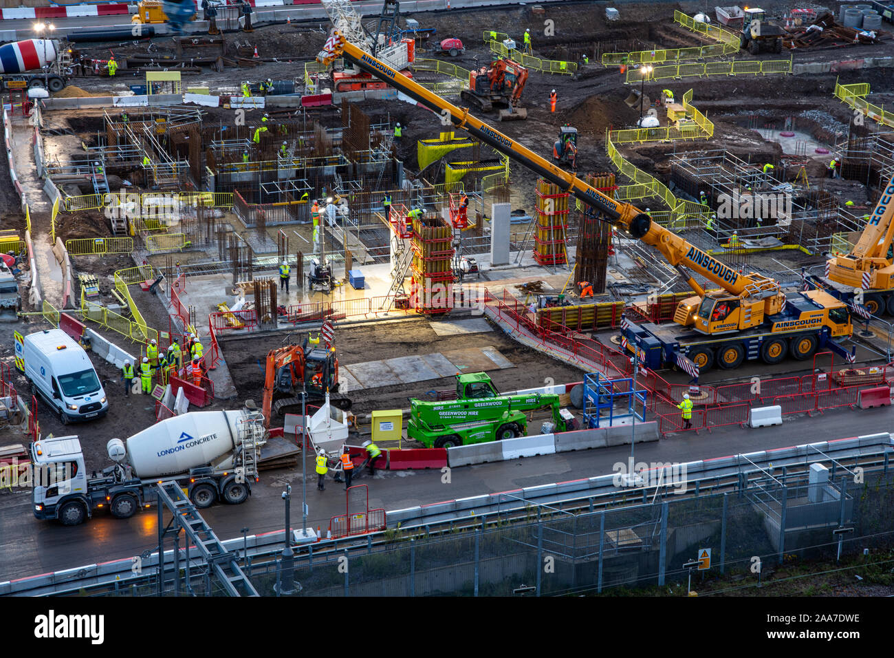 London, England, UK - November 4, 2019: Builders pour concrete at a construction site in the Olympic Park during regeneration of the Stratford neighbo Stock Photo
