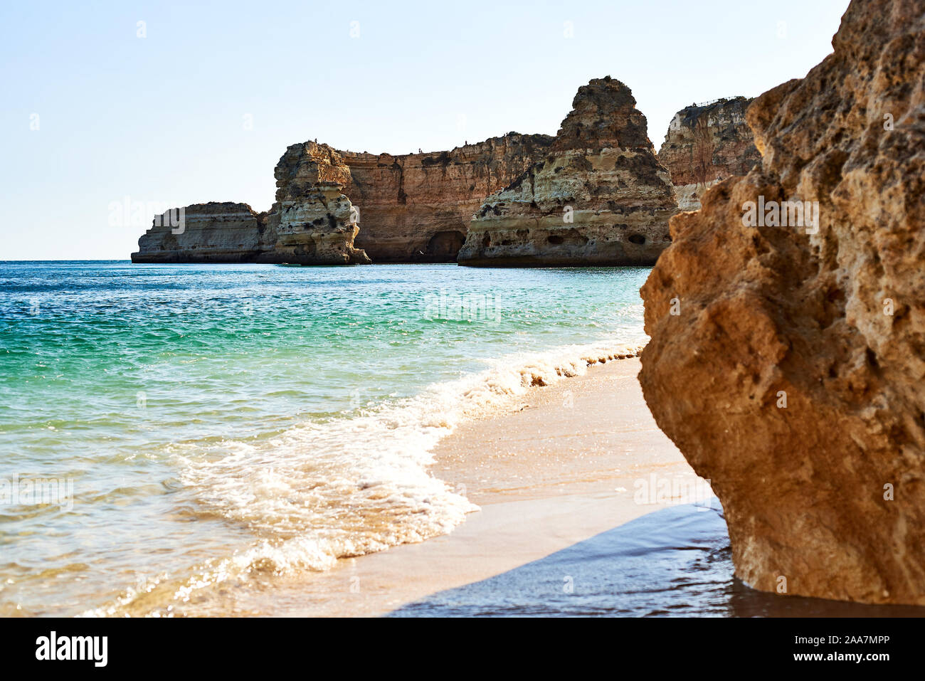 Rocks and sandy beach in Portugal, Atlantic coast. Stock Photo