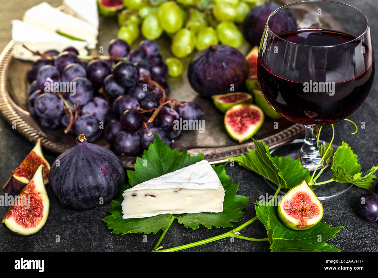 French Food Glass Of Red Wine And Snack Set Plate With Cheese Grapes And Figs Stock Photo Alamy