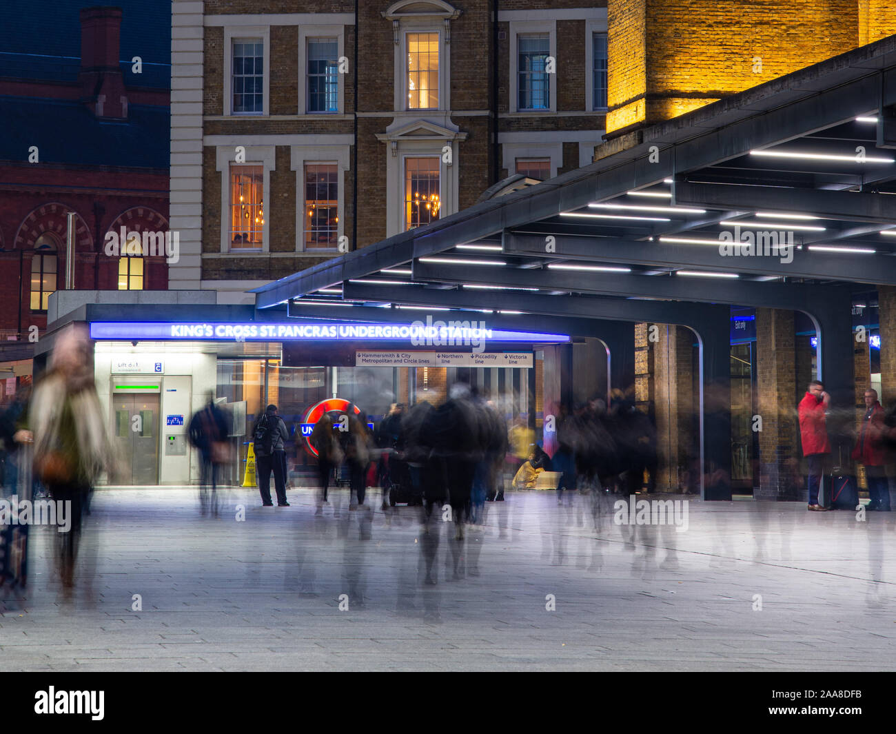 London, England, UK - November 22, 2018: Crowds of commuters walk through King's Cross railway station in London on a winter evening. Stock Photo