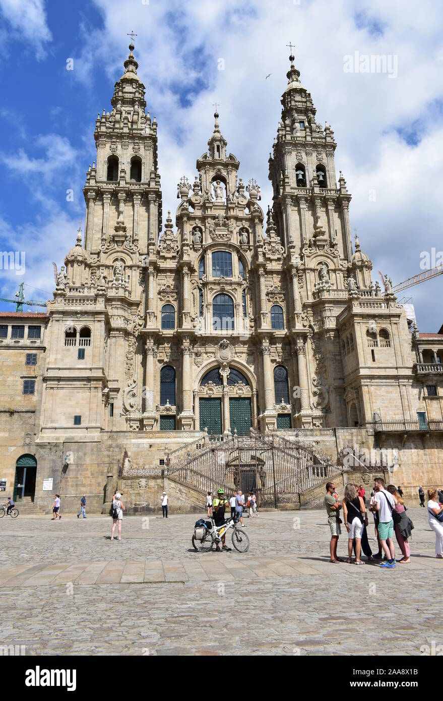 Santiago de Compostela, Spain. August 4, 2019. Cathedral with pilgrims taking pictures at final stage of Camino de Santiago. Plaza del Obradoiro. Stock Photo