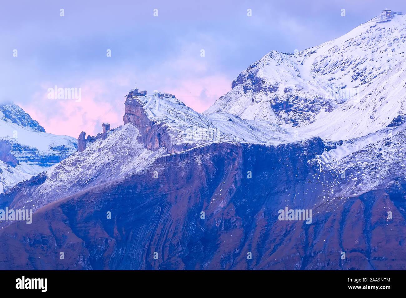 Panoramic view of Swiss Alps, Jungfraujoch region, pink sunrise, Schilthorn peak, Bernese Oberland, Switzerland Stock Photo