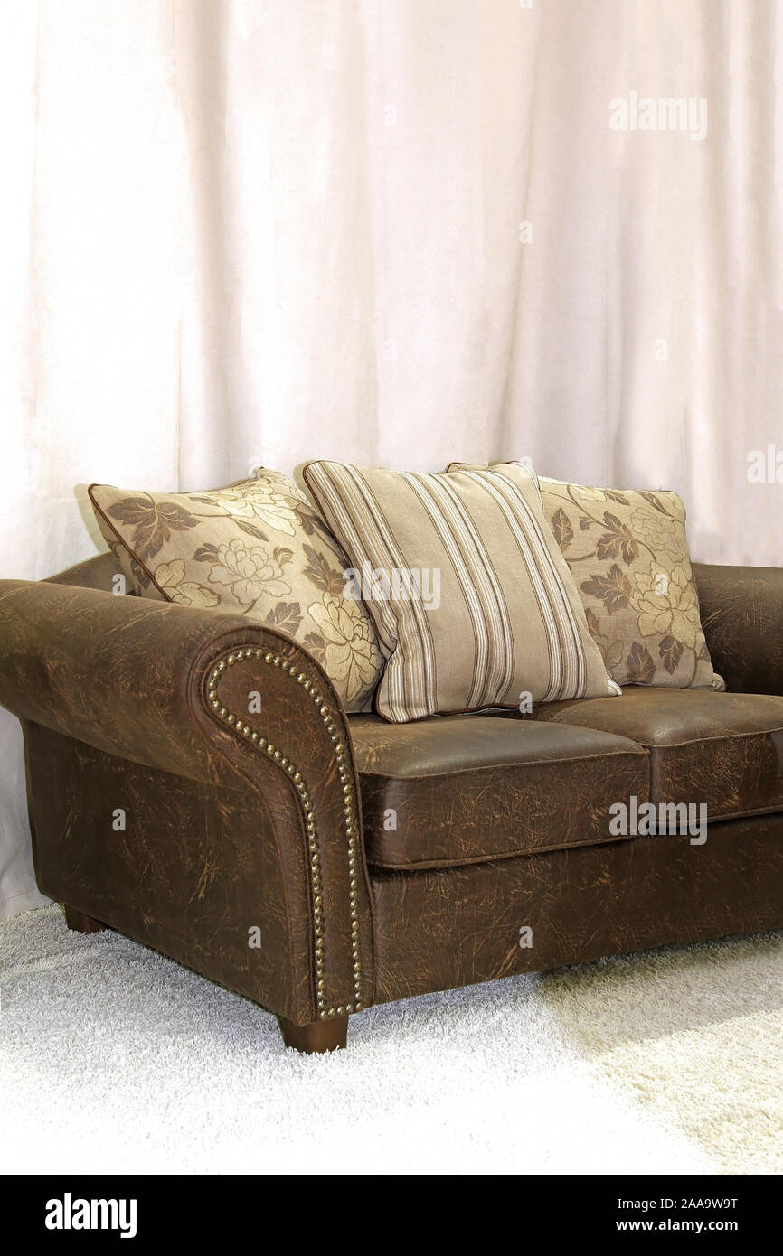 Retro leather sofa detail with decorative pillows Stock ...
