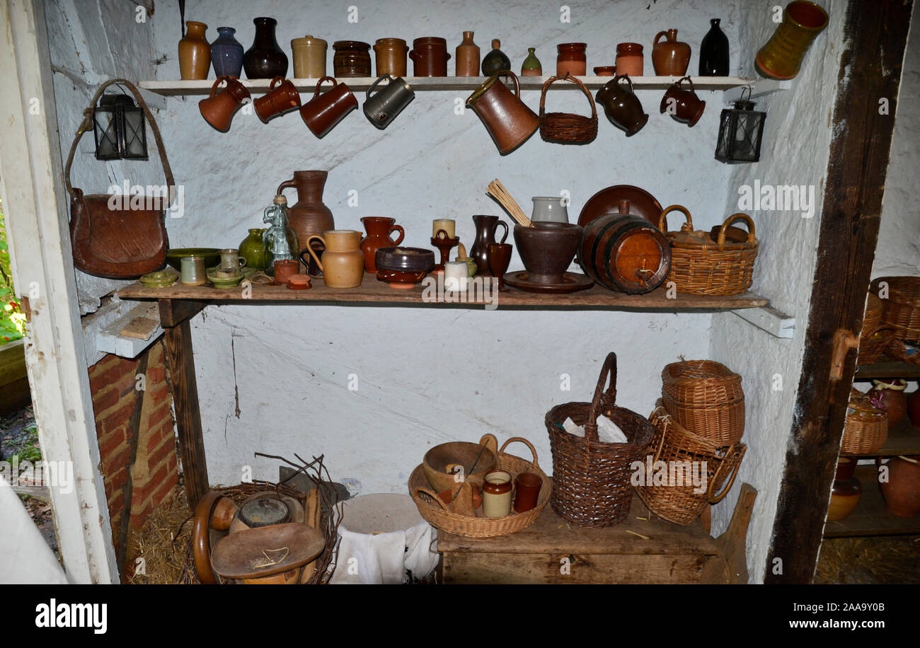 Kitchen shelves inside a house in the 17th Century Village, Gosport, Hampshire, UK Stock Photo