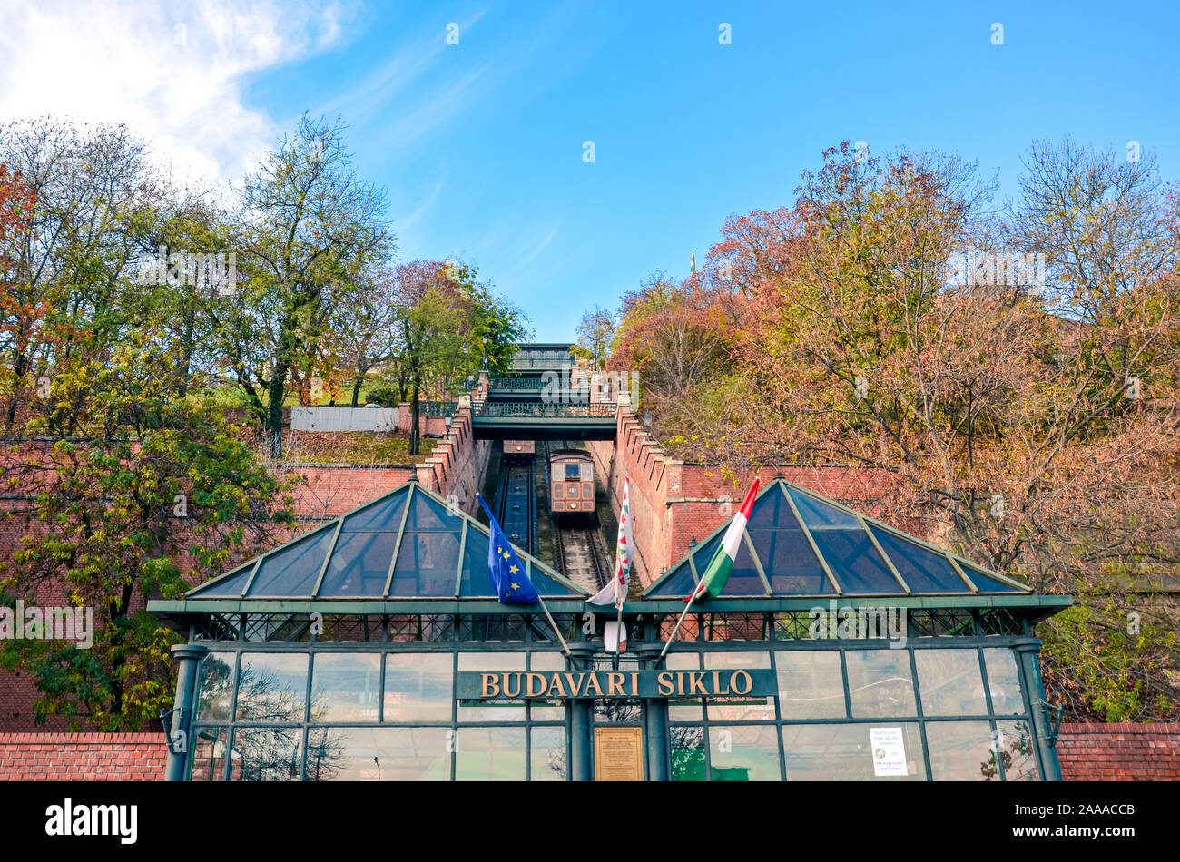 Budapest, Hungary - Nov 6, 2019: Cable car, public funicular train leading to the Buda Castle on the hill in the Hungarian capital. Tram tracks in the narrow corridor leading uphill. Transportation. Stock Photo