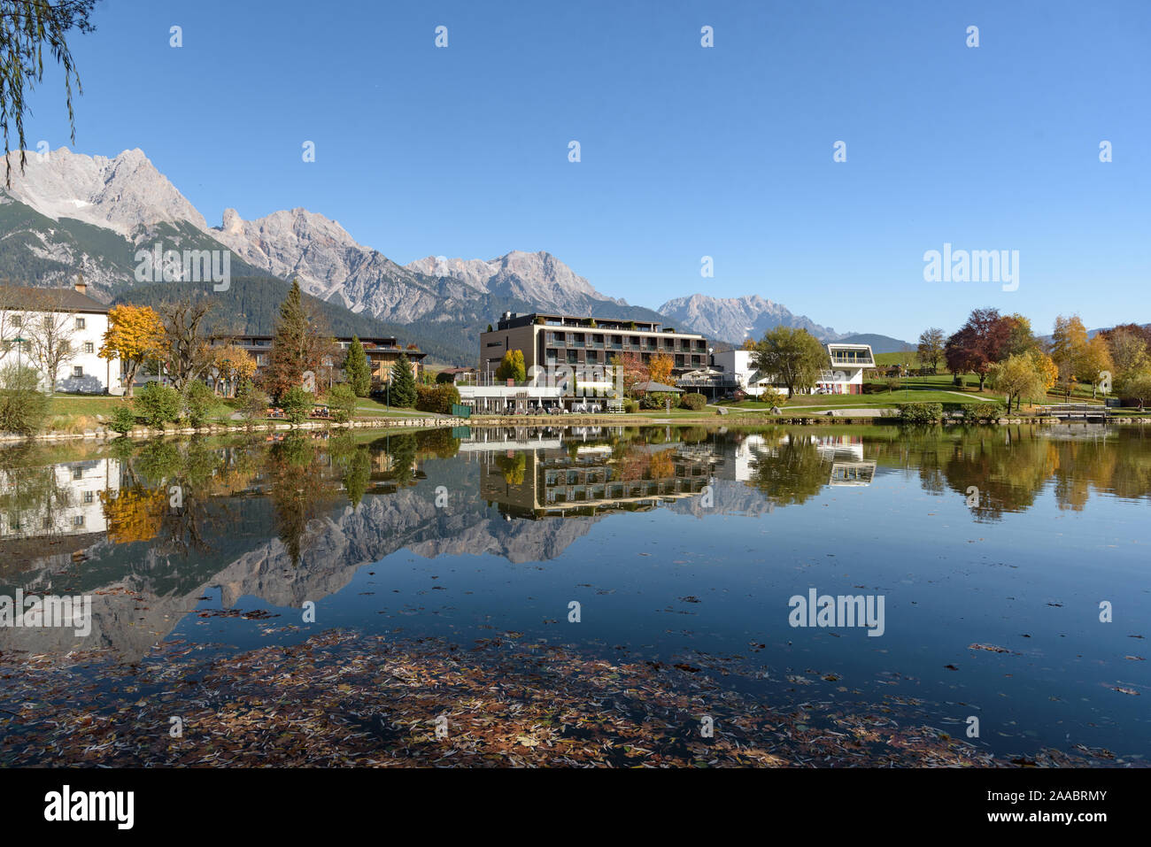 Ritzensee, Saalfelden, Salzburg/Austria, October 26, 2019: View of the nature bath at Ritzensee with the peaks of the Steinernes Meer reflecting in th Stock Photo