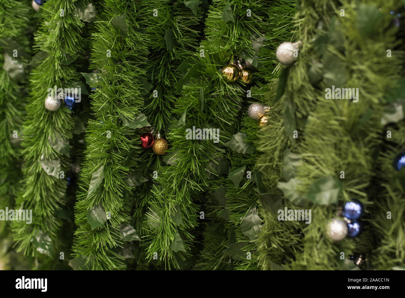 Sale Of Green Garlands In The Form Of Christmas Tree Branches In A Store Green Tinsel Is Hanging On The Shelves Of A Shop Window Stock Photo Alamy