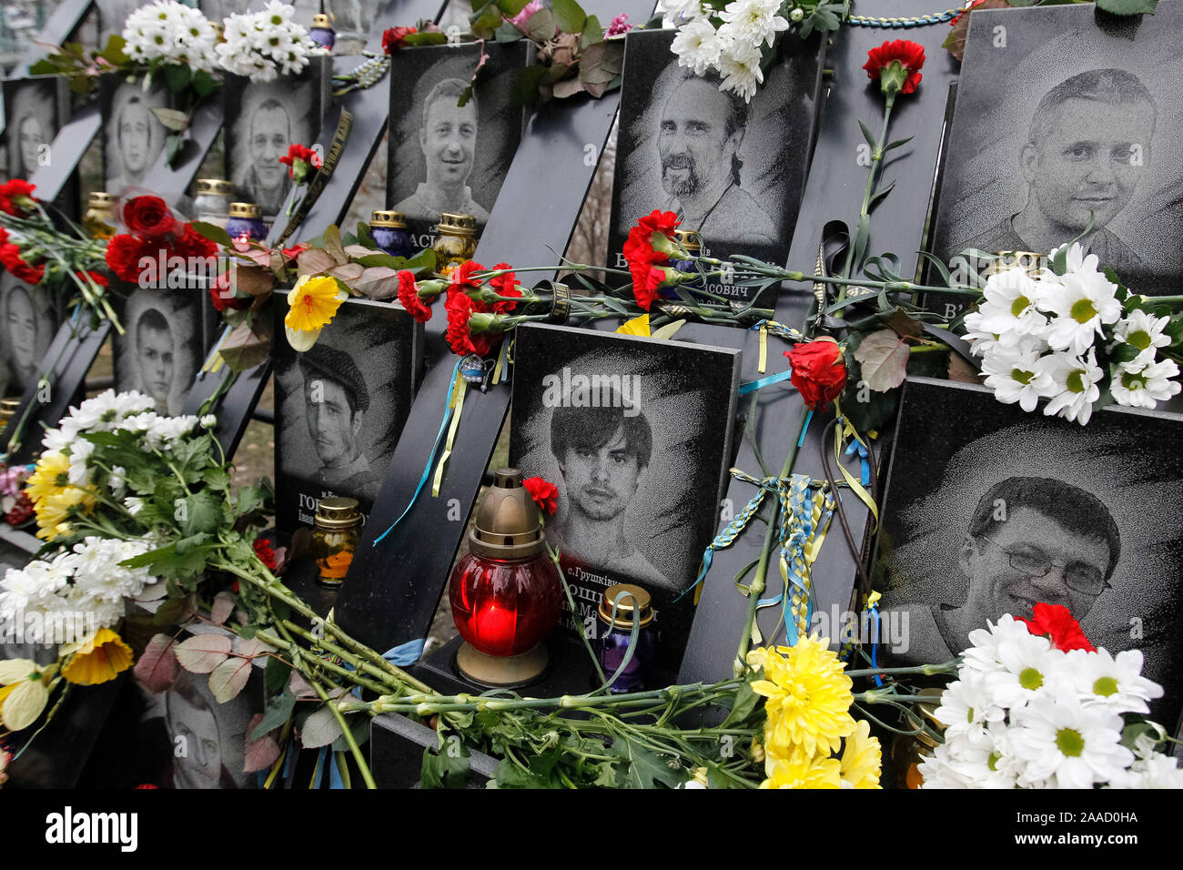 Flowers laid on portraits of dead Maidan activists (Heroes of the Heavenly Hundred) during the anniversary in Kiev.Ukrainians mark the 6th anniversary of the beginning of the Revolution of Dignity or the Euromaidan Revolution in which more than hundred anti-government protesters died. Stock Photo