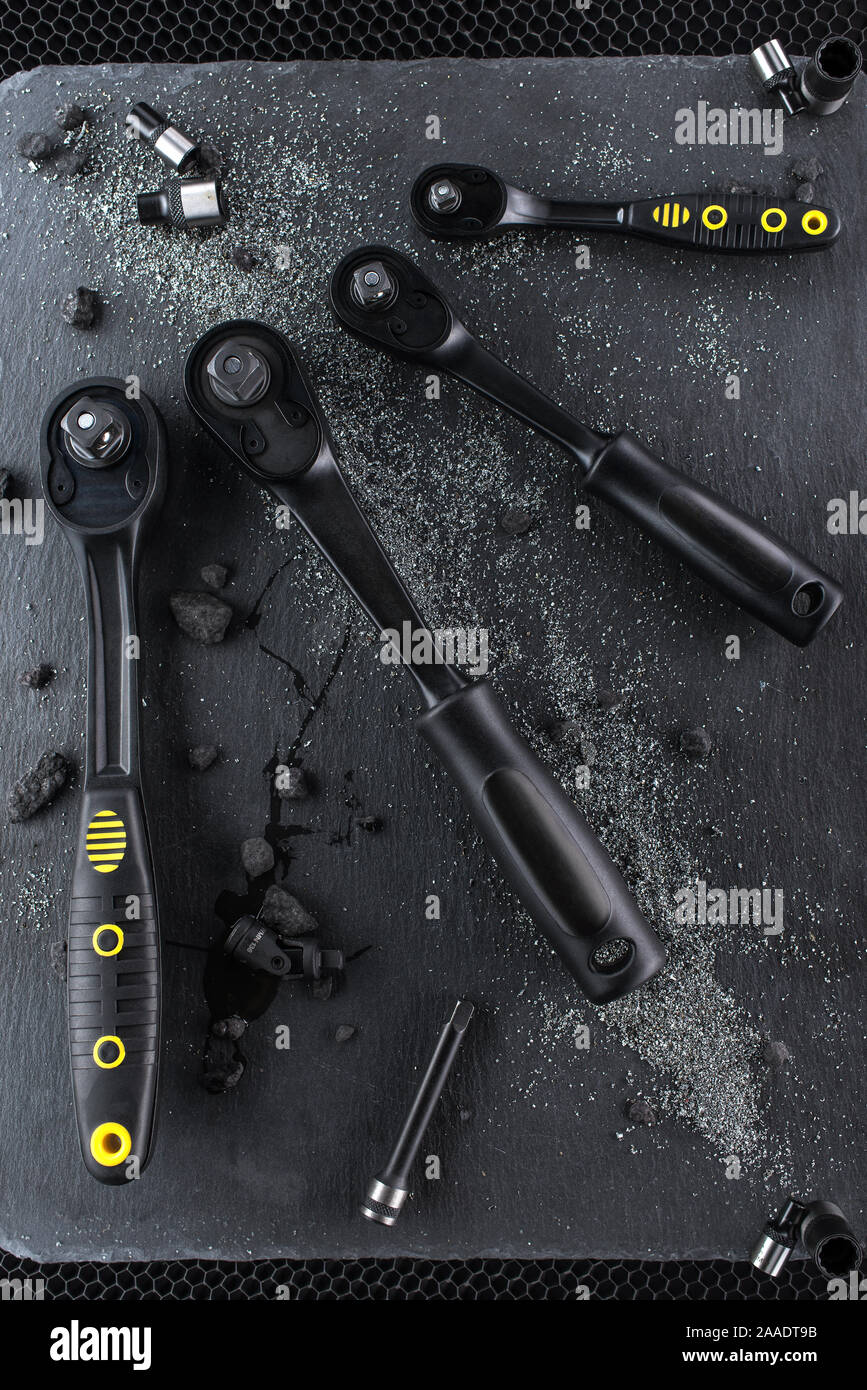 Professional ratchet tools placed on a black background, Wrench Tool for the work in the workshop. Stock Photo