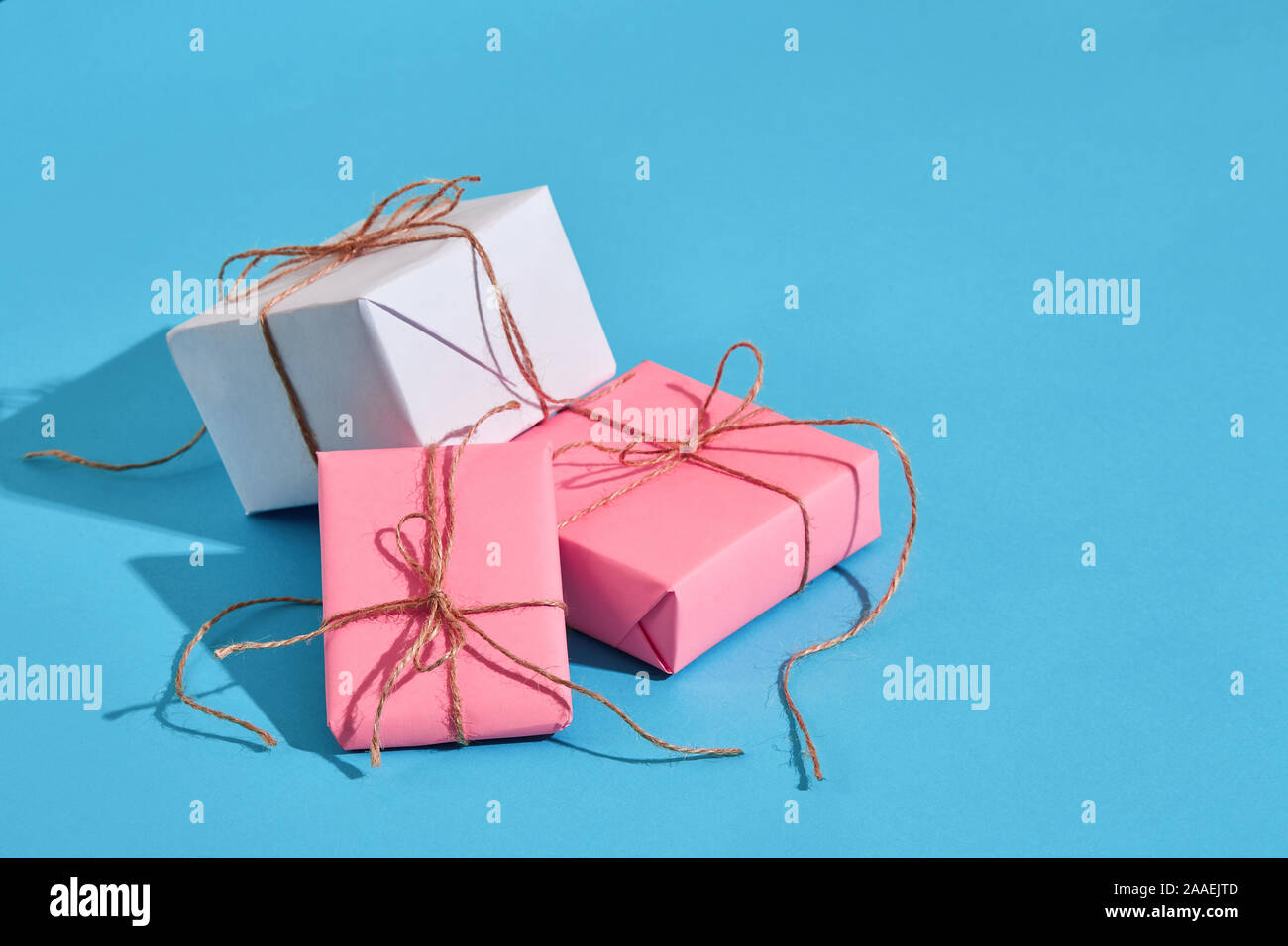 Craft paper wrapped present boxes craft rope bow ribbon with sha Stock Photo
