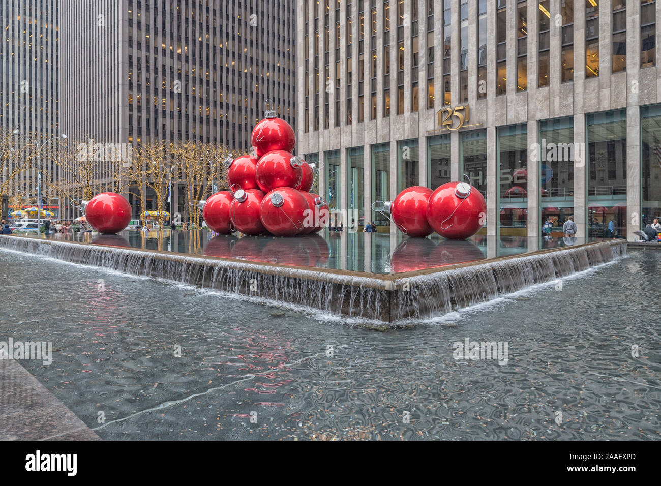 Giant Christmas ornament balls outside Rockefeller center on Sixth Ave, New York city,USA. Stock Photo
