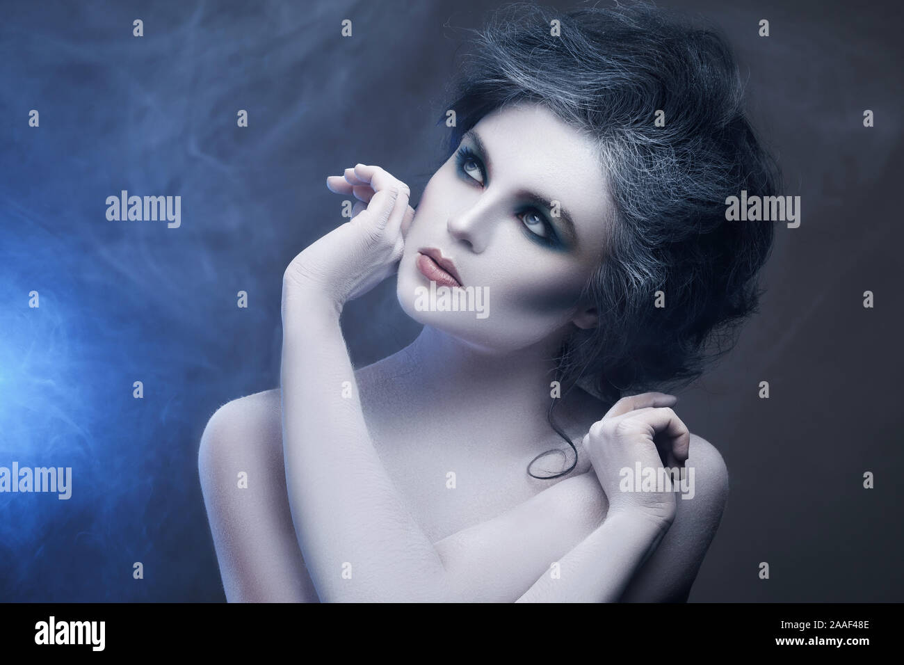 Woman With White Body Art In Creative Image Of Winter Snow Queen Or Another Sad Or Evil Character Stock Photo Alamy