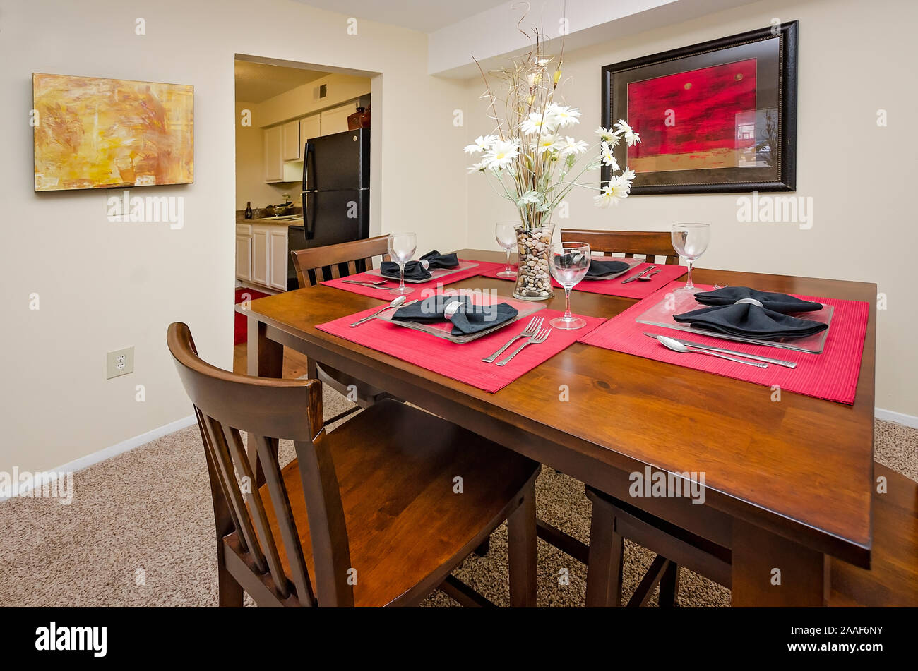 A dining room table features red placemats at Four Seasons ...