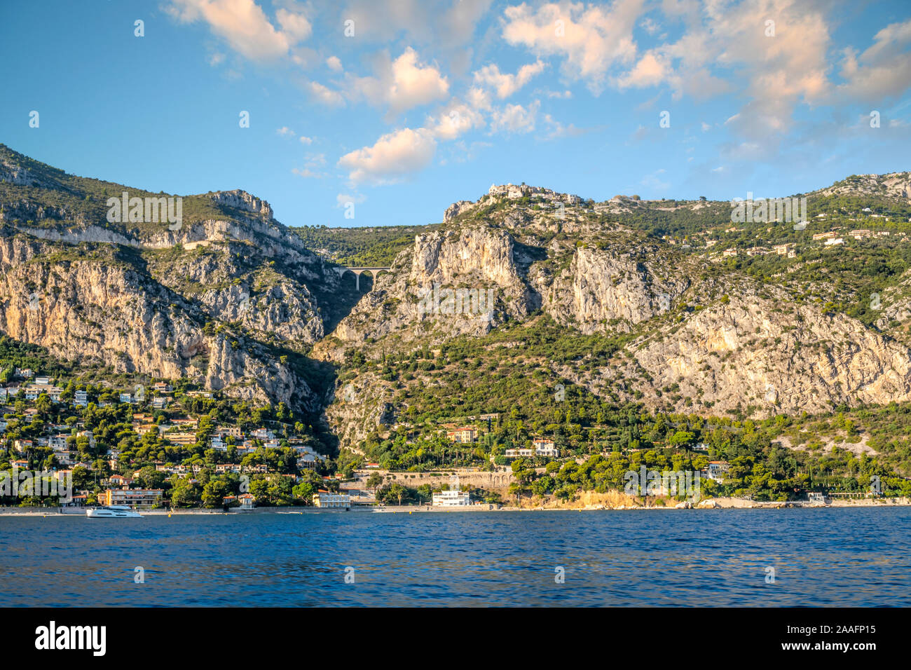 View from a boat at sea of the medieval hilltop village of Eze on the French Riviera in the South of France. Stock Photo
