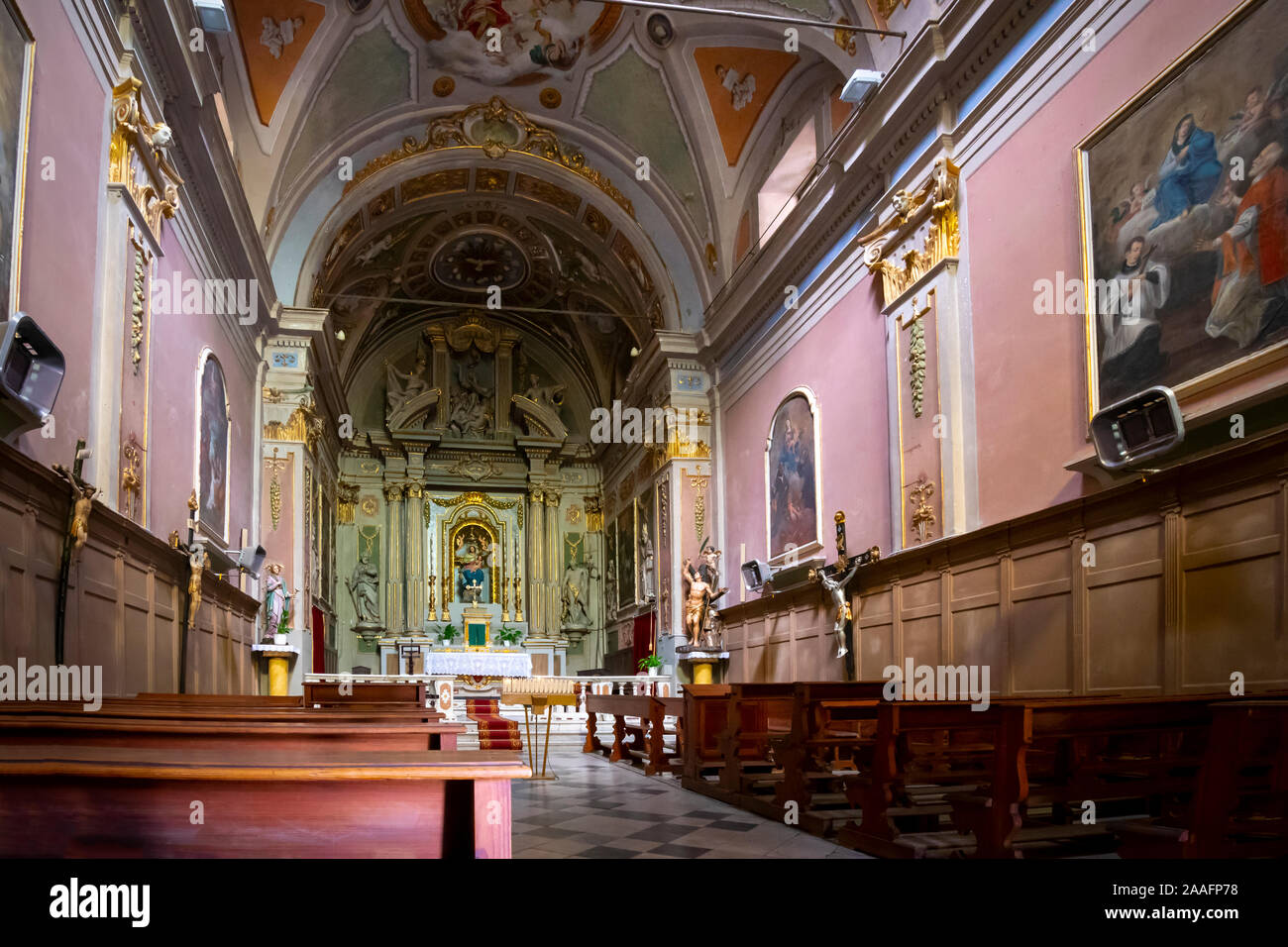 Interior of the Chiesa di San Sebastiano, a small 17th century church oratory with a wooden statue by Maragliano in the village of Dolceacqua, Italy. Stock Photo