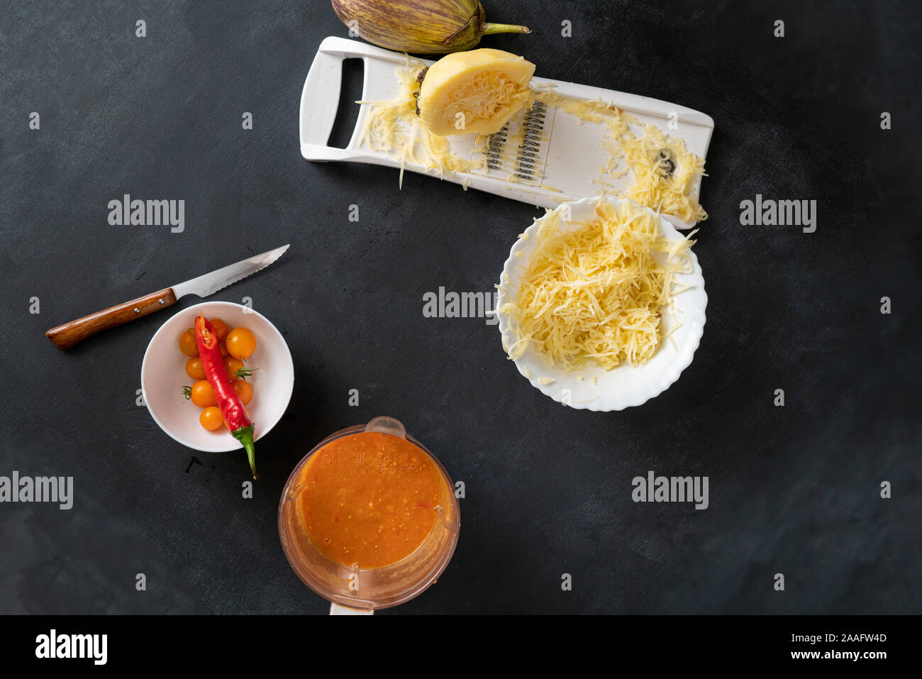 process of making and cooking the cut zucchini pasta spaghetti on the tables Stock Photo