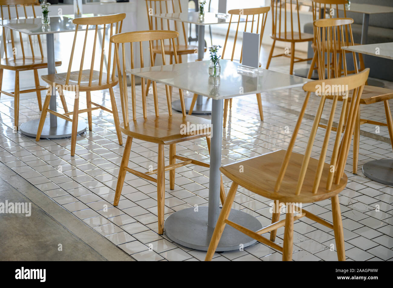 Marble Table With Wooden Chairs And Flower Decoration In Bistro Cafe Stock Photo Alamy