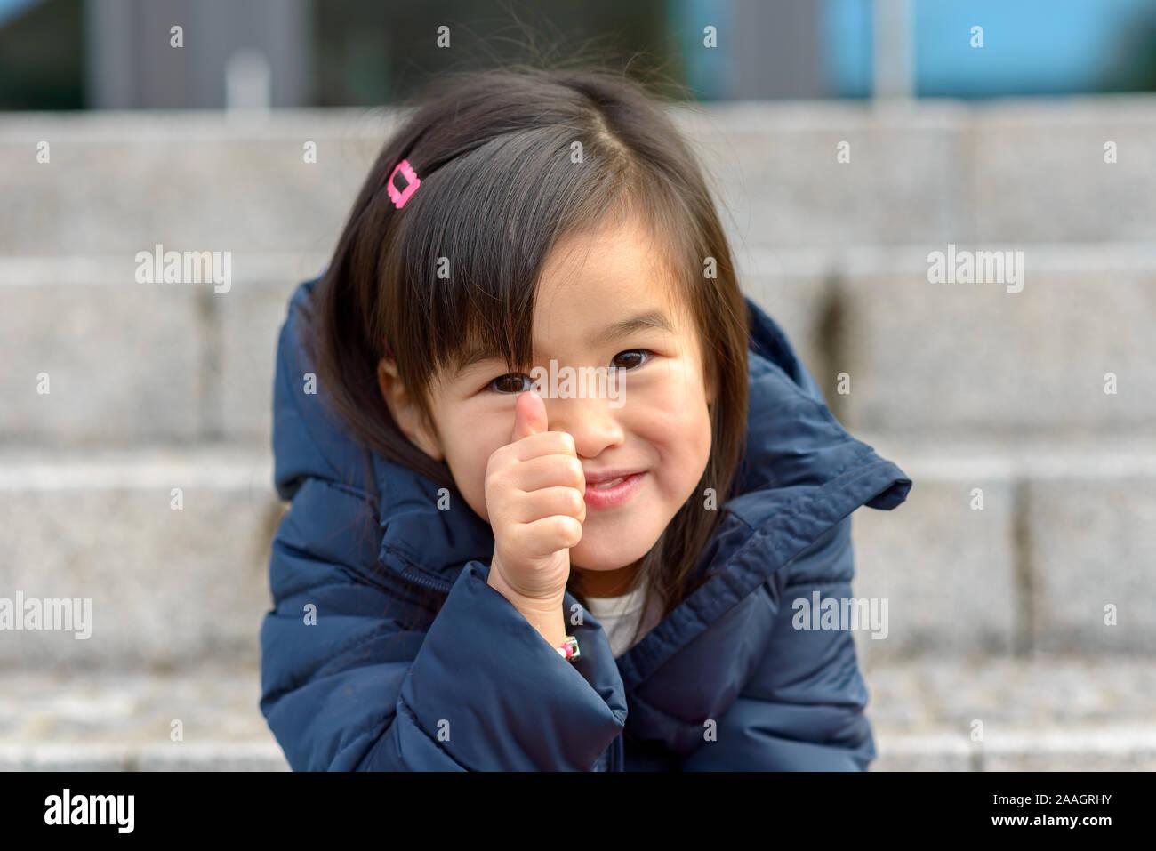 Girl little asian Two Black