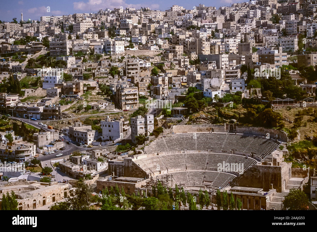 Jordan. Aerial view of the Jordan capital city of Amman from the Citadel overlook viewpoint on the ancient Roman site of Jabal al Qula'a Hill looking towards the ruins and remains of the Roman Amphitheatre in 1998 Stock Photo