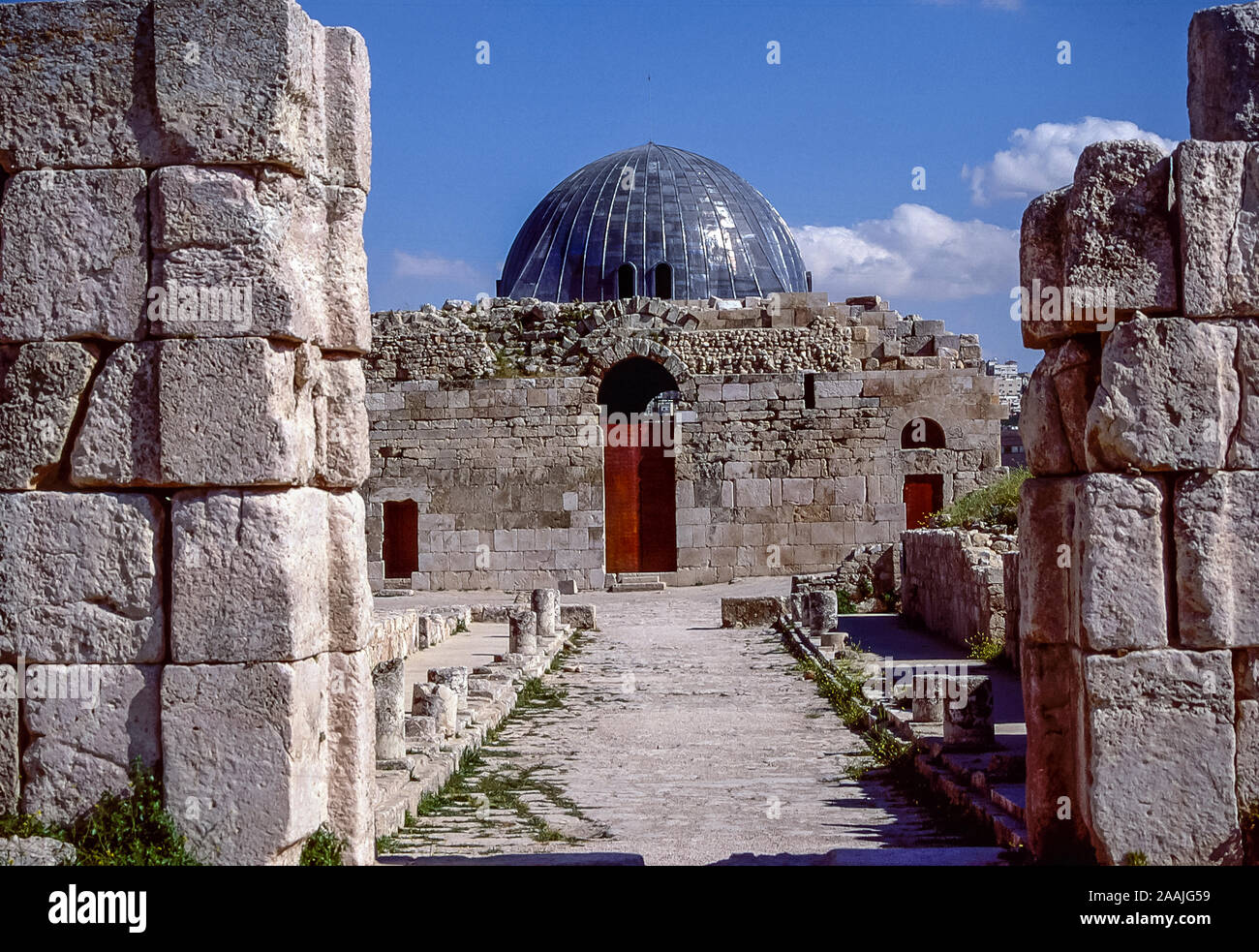 The remains and ruins of the ancient Roman Temple of Hercules and the Umayyad Palace at the Citadel on Jabal al Qula'a Hill overlooking the Jordanian capital city of Amman in the Middle East in 1998 Stock Photo