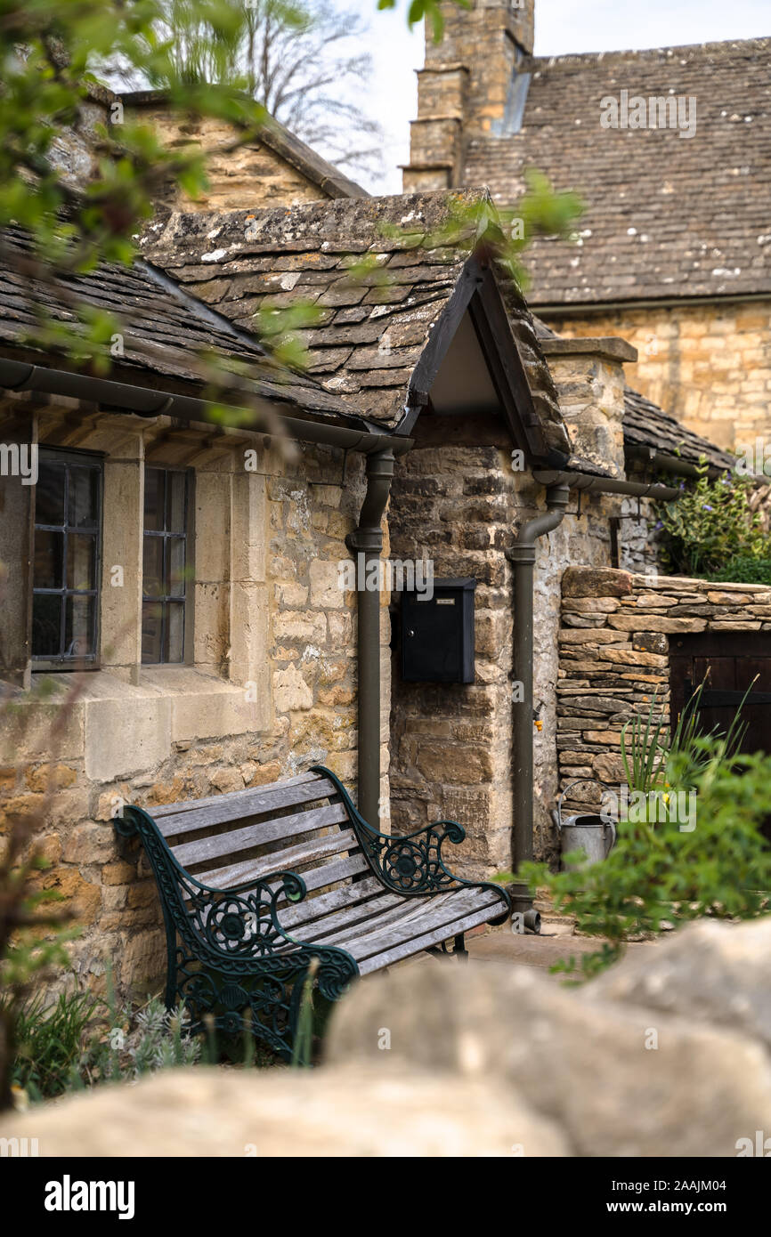 Cute traditional limestone stone houses in rural Britain, England, Cotswolds, United Kingdom. Stock Photo